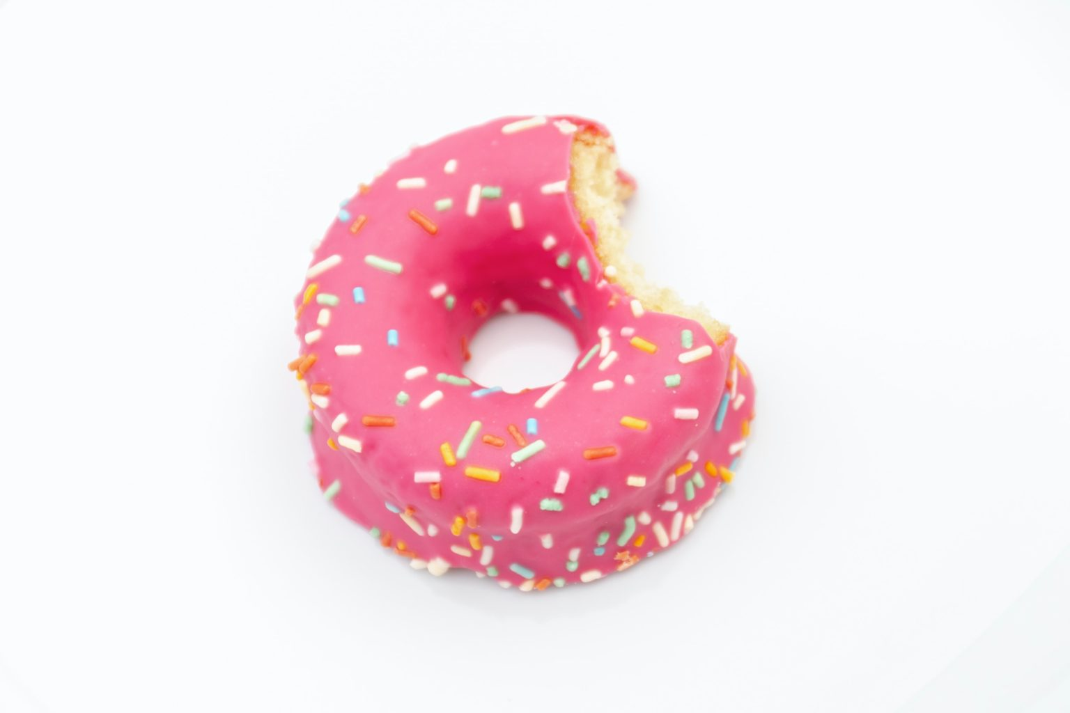 round doughnuts with sprinkles